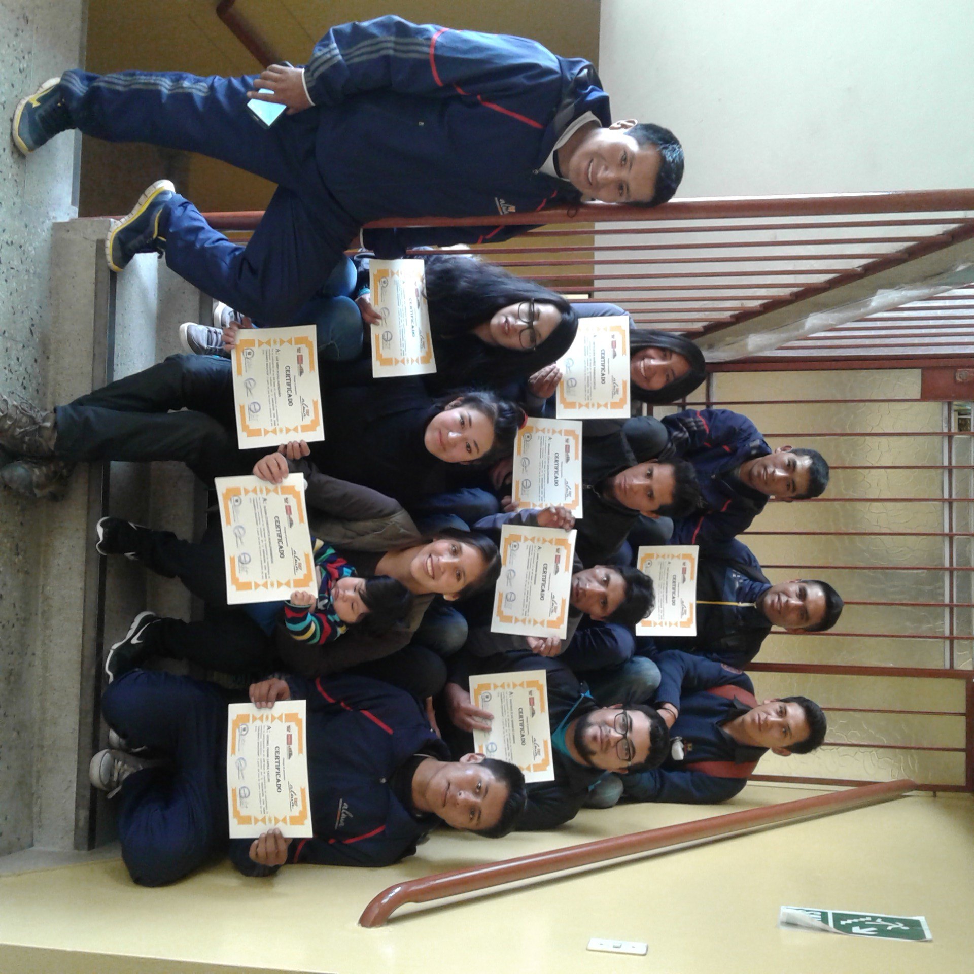 some of our 2016 primary school training graduates with certificates from Alma and UGEL